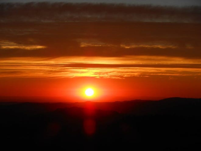 Sunset view from Cougar Rock, above Arnold.