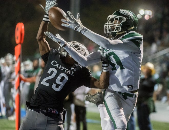 Manteca's Sunny Dozier, right, catches a pass over Capital Christian's Carlos Wilson in the end zone but the catch was ruled out of bounds during a Sac-Joaquin Section Division III football semi-final Nov. 29 at Capital Christian High school in Sacramento. [CLIFFORD OTO/THE STOCKTON RECORD FILE 2019]