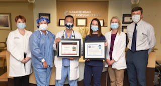 Members of Manatee Memorial Hospital's Chest Pain Committee are shown with the achievement award.