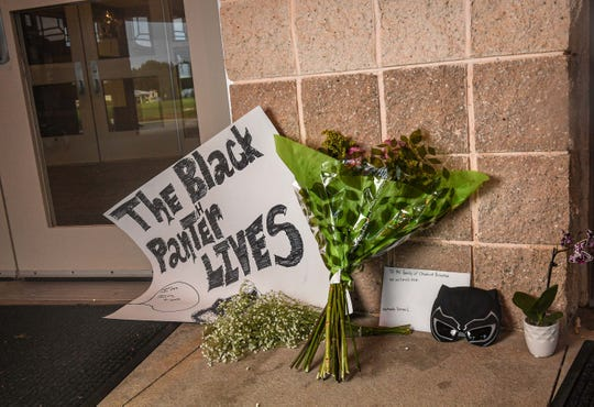 A makeshift memorial with a poster, flowers and a card for the Boseman family is set up at the front door of T.L. Hanna High School in Anderson, S.C., on August 31, 2020.