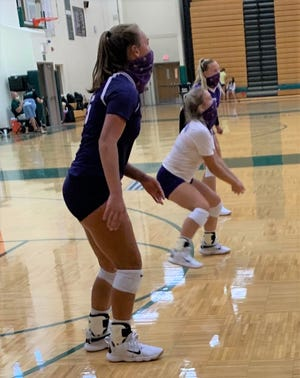 Bronson volleyball players, wearing masks, were able to get in some game action inside in a gym after the team drove four-plus hours to Traverse City West for a tournament.