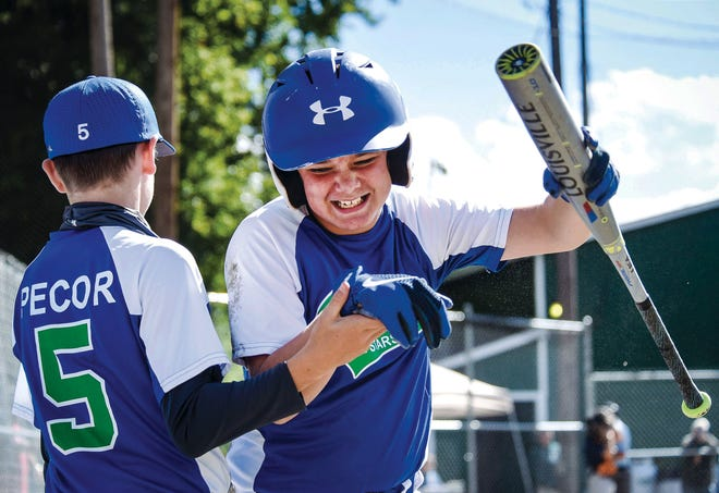 Vinny Wagoner celebrates scoring a run with teammate Jackson Pecor during second-seeded Colchester's 7-1 win over third-seeded Connecticut Valley North in a Vermont Little League 11-12-year-old state baseball tournament semifinal at Legion Field on Sunday, Aug. 30, 2020.