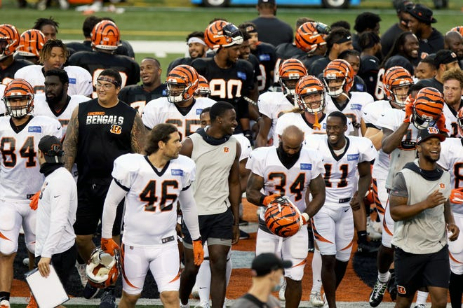 The Cincinnati Bengals leave the field after a scrimmage at Paul Brown Stadium Sunday August 30, 2020.