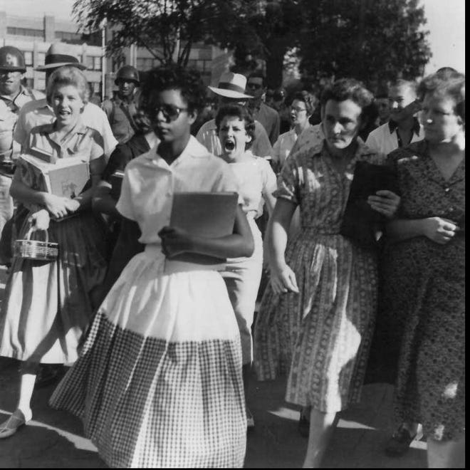 Whites harass Elizabeth Eckford, one of nine African-American students attempting to attend Central High School in Little Rock, Ark., on Sept. 4, 1957. The governor sent National Guard troops in to keep the nine out.