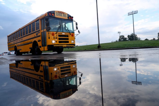 A school bus approaches the drop off point with a load of students at West Creek High School in Clarksville, Tenn., on Monday, Aug. 31, 2020.