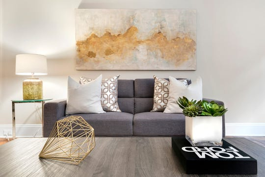 A small scale sofa is used in the living area of an urban apartment.