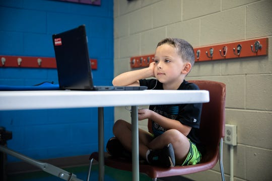 Evan Rains, 5, a kindergarten student, works on a laptop at the Eastside Family YMCA in Taylors, Monday, August 31, 2020.