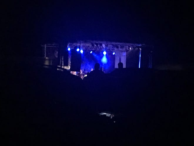 Concertgoers enjoy Casting Crowns from the back of their pickup truck at Birdsong Drive-In Theater.