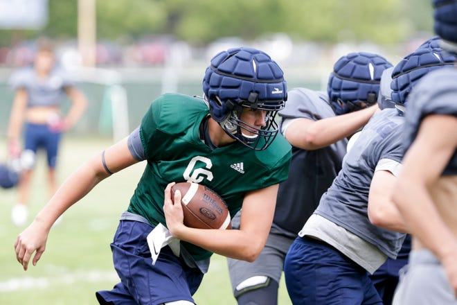 Clark Barrett runs the ball during a football practice at Central Catholic High School, Monday, Aug. 31, 2020 in Lafayette.