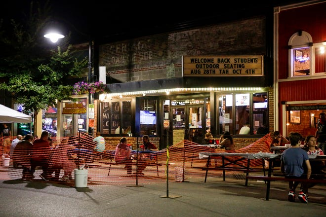 """Patrons utilize tables outside of DT Kirby's and Professor Joe's Pizza for dining, Saturday, Aug. 29, 2020 in Lafayette. The promotion, which the city has named """"Fresh Air Eats,"""" will run for the next five weekends and will close several streets, providing outdoor dining space for restaurants to safely increase their capacity, similar to other promotions in other cities, including Indianapolis' outdoor dining experience."""