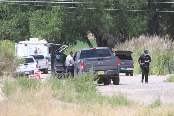 Investigators work the scene of an officer-involved shooting. A San Juan County Sheriff's Office deputy shot and killed a robbery suspect on the morning of Aug. 31 near the intersection of County Road 3177 and 3100 in the Crouch Mesa area.