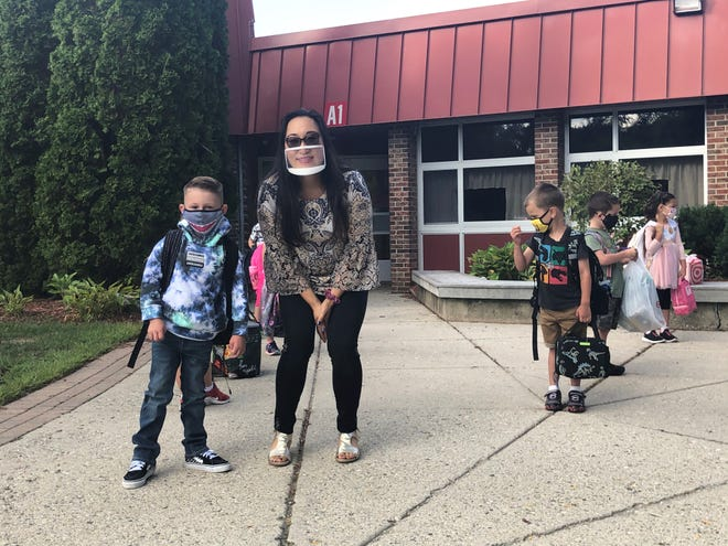 Susan Dinnan, a Kurtz Elementary kindergarten teacher, with new student, Cason Keatts, 5, show the new back to school fashion trends for the 2020-21 school year on Aug. 31, 2020.