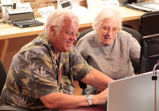 A technology instructor at the Braille Institute works with a student.