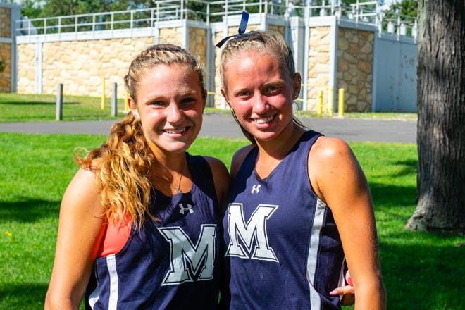 Marysville juniors Hannah Fisher, left, and Reese Powers pose for a portrait after running in the Skipper Early Bird Invite Monday, Aug. 31, 2020, at Marysville Municipal Park. The two friends took first and second in the girls' race.