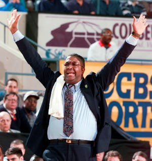 """FILE - In this March 15, 1996, file photo, Georgetown head coach John Thompson yells to his players during the second half of a first round NCAA college basketball game at the Richmond Coliseum in Richmond, Va. John Thompson, the imposing Hall of Famer who turned Georgetown into a """"Hoya Paranoia"""" powerhouse and became the first Black coach to lead a team to the NCAA men's basketball championship, has died. He was 78 His death was announced in a family statement Monday., Aug. 31, 2020. No details were disclosed. (AP Photo/Doug Mills, File)"""