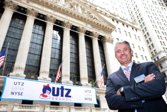 In this photo, provided by the New York Stock Exchange, Utz Brands, Inc. CEO Dylan Lissette poses for photos outside the NYSE as his company is listed, Monday, Aug. 31, 2020. (Nicole Pereira/New York Stock Exchange via AP)