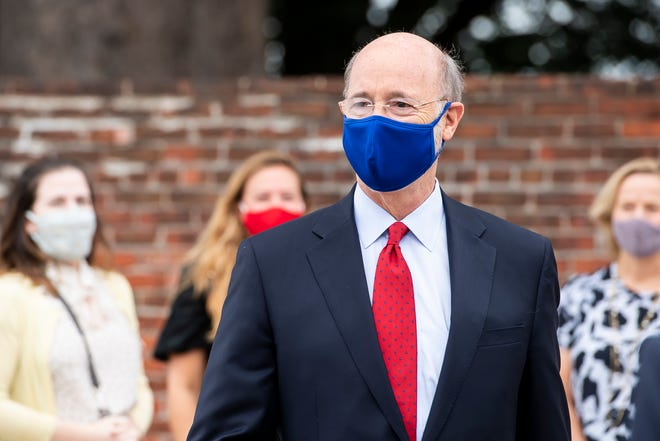Governor Tom Wolf arrives for a press conference in Harrisburg, Pa., on Monday, August 31, 2020.