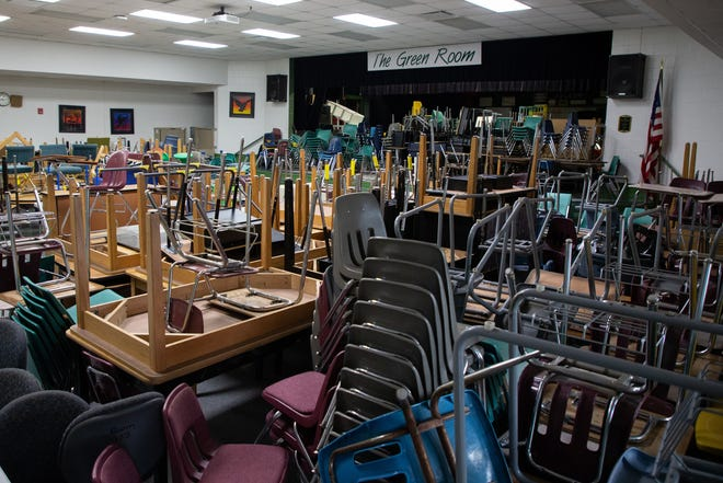 Furniture which was removed from classrooms to make room for social distancing is stacked up in the auditorium at Fort Braden School on the first day of classes Monday, August 31, 2020.