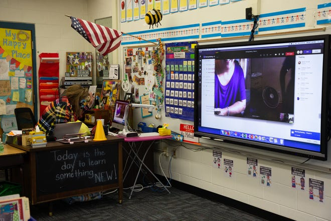 A Fort Braden School teacher greets students tuning into class digitally on the first day of school Monday, August 31, 2020.