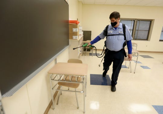 Head custodian Jim McNamara sprays a classroom with disinfectant at Monroe-Woodbury High School Aug. 31, 2020. Classrooms will be disinfected at the end of every school day when students start in person learning later in September. In addition, the custodial staff will disinfect high touch areas throughout the school day. The same safety procedures will be followed at all Monroe-Woodbury Schools as the school year commences during the COVID-19 pandemic.