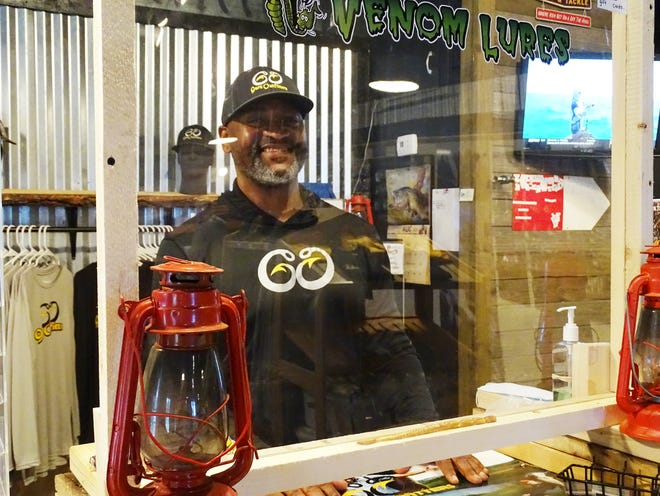 Corneilus Harris stands at the helm of his new Guru Outfitters bait and tackle shop in Chandlersville. Guru Outfitters also guides fishing trips in the AEP ReCreation Lands.