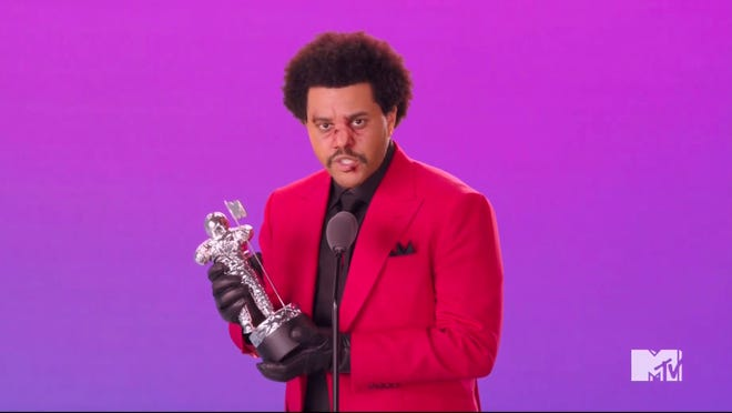 "The Weeknd accepts the award for best R&B video for ""Blinding Lights."""