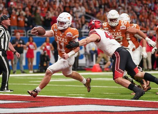 Texas quarterback Sam Ehlinger runs in for a touchdown against the Utah during the 2019 Alamo Bowl.