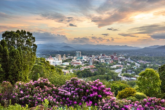Asheville, North Carolina, is nestled among the Blue Ridge Mountains and surrounded by close to one million acres of wilderness areas and parks, including the famed Blue Ridge Parkway.