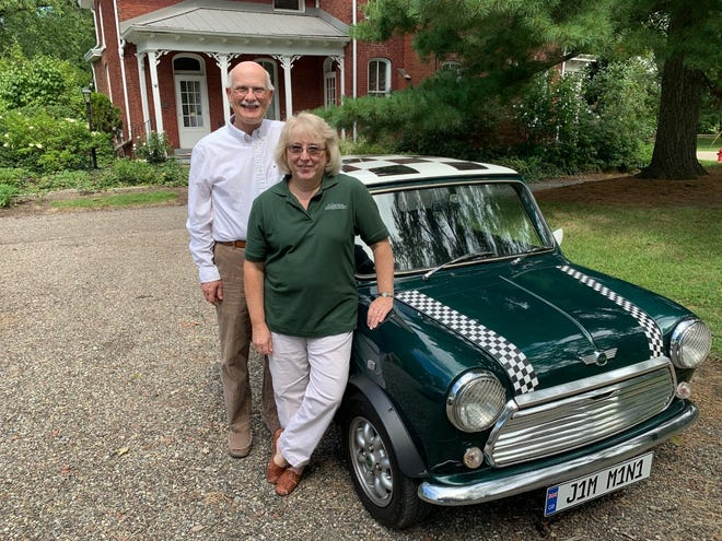 """Karenand Jim Perone have been honored by an Ohio historical organization for their """"MarkingTimein Alliance"""" video series about localhistorical sightsand events, whichalsofeatures Jim's 1973 Austin Mini."""