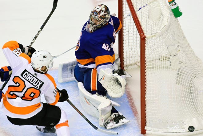 Islanders goaltender Semyon Varlamov covers the side of net as the Flyers' Claude Giroux watches the puck go wide during Game 3 on Saturday night in Toronto.