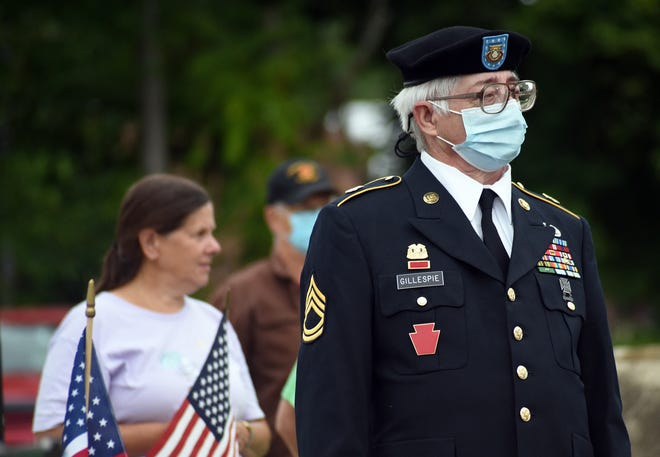 John Gillespie of Georgetown, a U.S. Marine Corps veteran, wears his dress uniform to say goodbye to a group of local World War II and Korean War veterans who boarded a bus Tuesday morning in Beaver en route to the National D-Day Memorial in Bedford, VA. Gillespie served his country for 41 years.