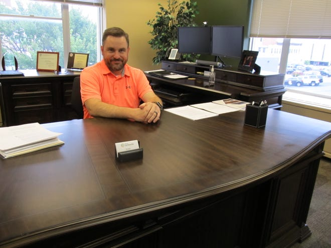 Bartlesville City Manager Mike Bailey at his desk in City Hall.