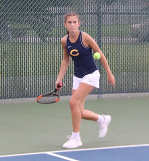 Hayden Winjum eyes the ball in her win at No. 2 singles Tuesday. Winjum helped Crookston to a 6-1 win over Park Rapids.