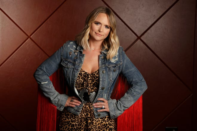 "FILE - This Oct. 9, 2019 photo shows country singer Miranda Lambert posing in Nashville, Tenn., to promote her latest album ""Wildcard.""  Lambert is the leading nominee at the 2020 Country Music Association Awards with seven nominations, including entertainer of the year.(AP Photo/Mark Humphrey, File)"