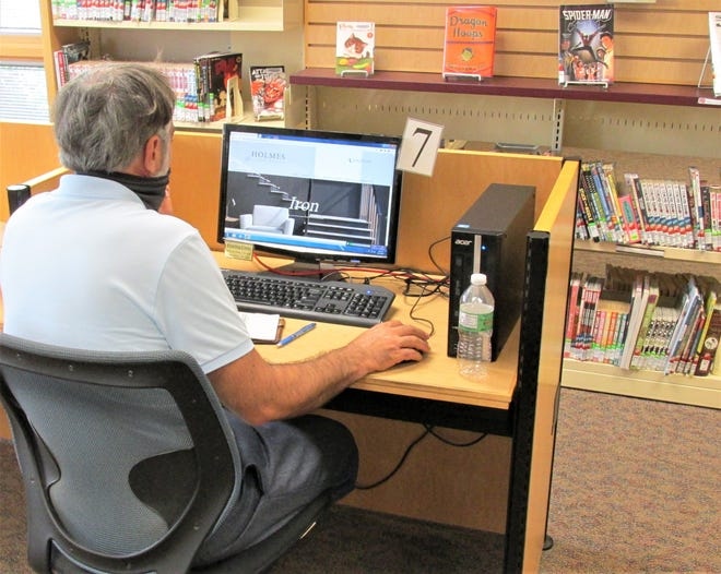 A patron at the Holmes County District Public Library searches the internet on a library computer. Thanks to a grant, the library is expanding it WIFI services beyond the building.