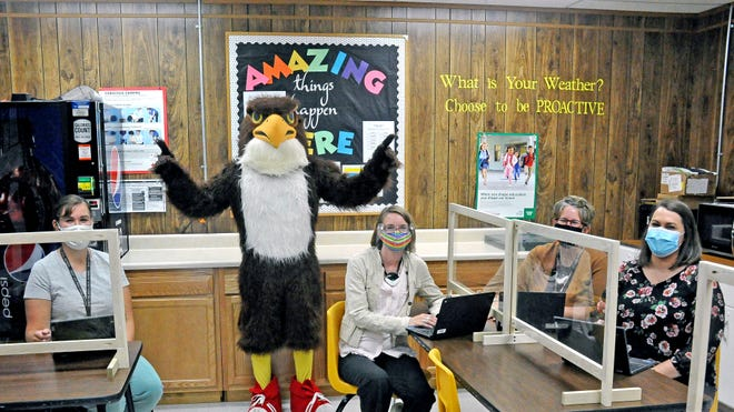 The Hiland Hawk made a visit to Berlin Elementary to meet with intervention specialist Kary Stockwell, first grade teachers Megan Mullett and Sherri Mullett, and multiple disabilities teacher Marjorie Abundo. Businesses in the area are donating items for raffle or silent auctions to the school for the purchase of technology like the chromebooks they each have.