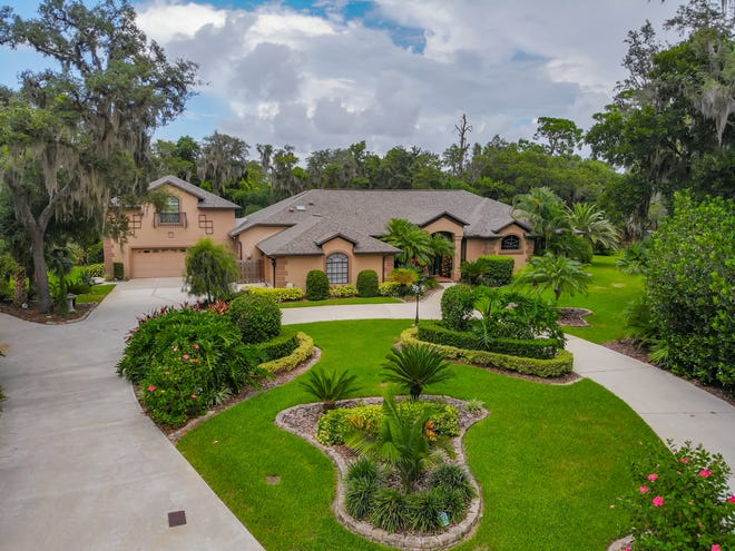 This exceptionally well-cared-for entertainer's dream home is nestled on more than an acre in the exclusive Spruce Creek Estates neighborhood of Port Orange.
