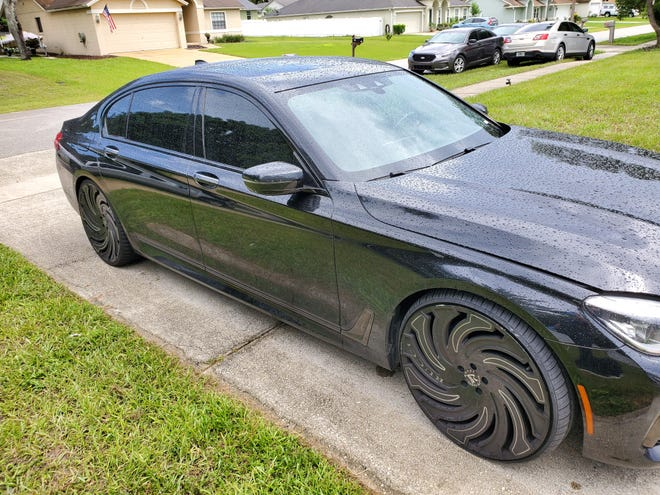 Volusia County deputies said this BMW is one of several luxury cars found at the home of a Deltona man who was arrested for his involvement in a luxury car theft scheme from Washington.
