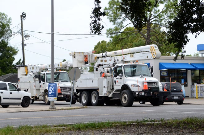 Entergy trucks staged along Marchand Drive in Donaldsonville the evening of Aug. 26, prepared to respond to outages as Hurricane Laura loomed in the Gulf of Mexico. Entergy Louisiana representatives said crews in the thousands were ready to respond to damages and outages throughout the state.