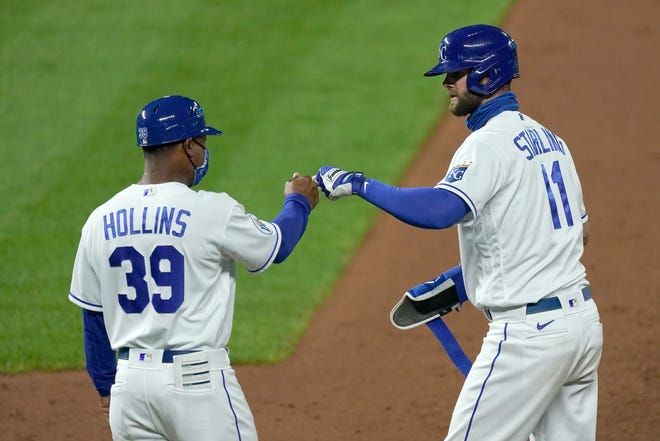 Kansas City Royals' Bubba Starling (11) celebrates with first base coach Damon Hollins (39) after hitting an RBI single in the eighth inning of Monday's game against the Cleveland Indians at Kauffman Stadium. Starling's lifted the Royals to a 2-1 victory.