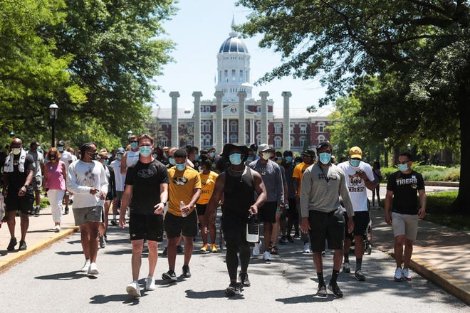 Missouri athletes and coaches walk from the Francis Quadrangle toward downtown Columbia on June 3 during a march against racial injustice and the death of George Floyd. A similar march is planned for Wednesday.