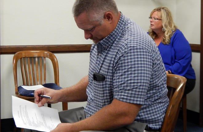County engineer Brian Carter checks the schedule at the Des Moines County Supervisors meeting on Tuesday Sept. 1 2020 as county treasurer Janelle Nalley-Londquist listens to county auditor Terri Johnson's report on upcoming elections.