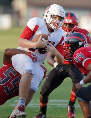Baldwin quarterback Bryce Tompkins (18) scrambles for yardage against the Westside defense in 2019.