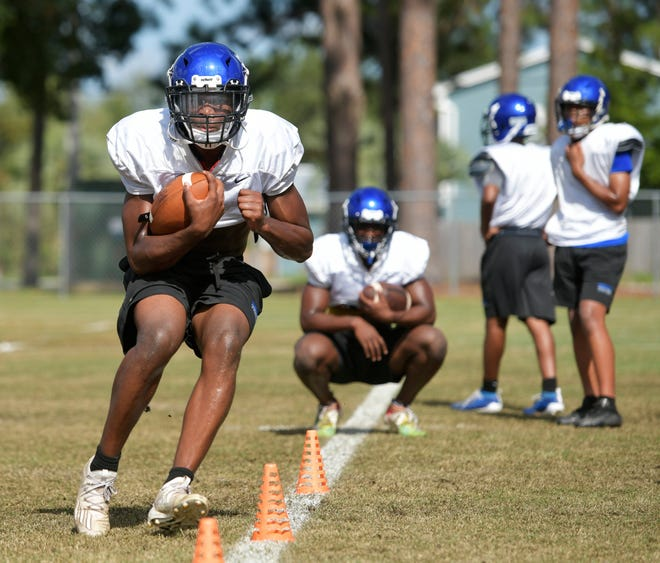 Trinity Christian sophomore running back Treyaun Webb runs high school football drills during an Aug. 27 practice.