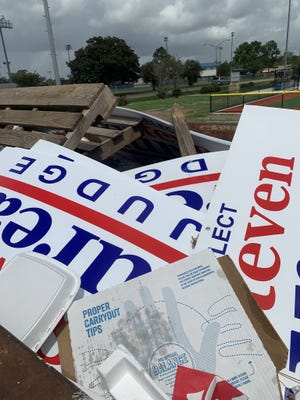 A social media post shows campaign signs discovered inside a Gonzales dumpster.