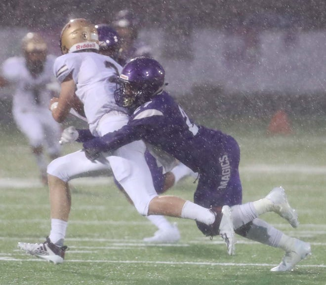 Stow quarterback Owen Bainbridge gets tackled by Barberton's Demarion Cook during their game at Barberton High Aug. 28. Stow won 16-8 as the game was completed Aug. 29 due to lightning.