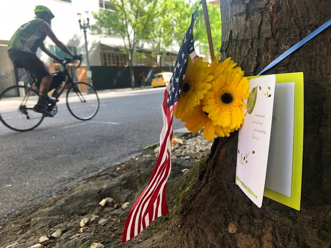 A small memorial to Portland, Oregon, fatal shooting victim Aaron J. Danielson, 39, of Portland is shown on Monday at the site where he was killed on Saturday as supporters of President Donald Trump and Black Lives Matter protesters clashed. Danielson was a supporter of the right-wing Patriot Prayer group, but few details have emerged about what led up to the shooting. No suspects have been arrested.