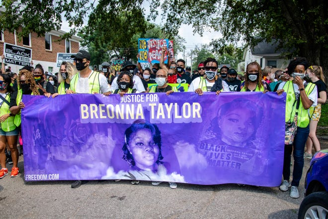 Protesters participate in the Good Trouble Tuesday march for Breonna Taylor last month in Louisville, Ky.  A lawyer for Breonna Taylor's family said a plea deal was offered to an accused drug trafficker that would have forced him to implicate Taylor, who was killed by police in a raid on her home in March. Louisville's top prosecutor acknowledged the existence of the document but said it was part of preliminary plea negotiations with a man charged with illegal drug trafficking and not an attempt to smear Taylor.