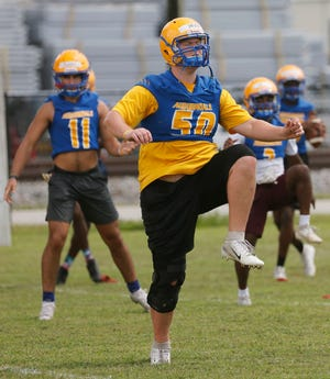 Dave Drier runs through a drill during football practice at Auburndale High School. While Polk teams returned to practice in August, schools in Miami-Dade will start too late to be able to play in the postseason, prompting complaints from people in that area.