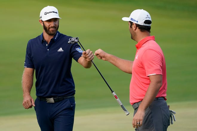 Jon Rahm, right, is congratulated by Dustin Johnson on the first playoff hole during the final round of the BMW Championship golf tournament at the Olympia Fields Country Club in Olympia Fields, Illinois, on Sunday.
